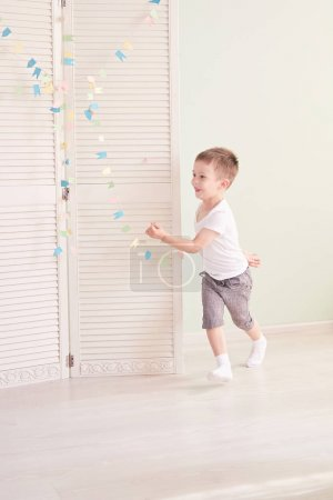 Photo for Boy jumping, running isolated on white background - Royalty Free Image