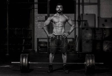 Man about to lift Barbell