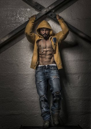 Muscular Man with Hoodie showing abs