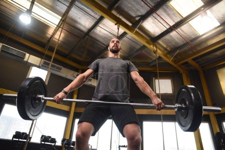 athlete completing heavy lift in gym