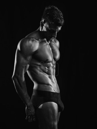 Mature Muscular bodybuilder in black underpants