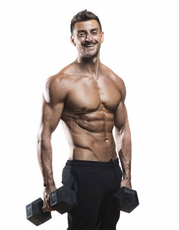 Muscular bodybuilder holding dumbbells