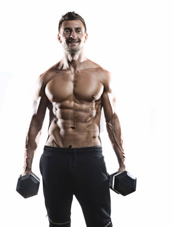 Muscular bodybuilder holding dumbbells