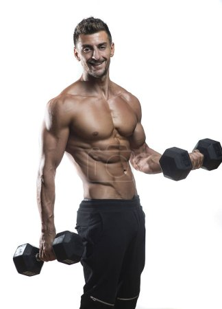 Muscular bodybuilder holding dumbbells weights