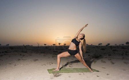 woman doing yoga in savanna
