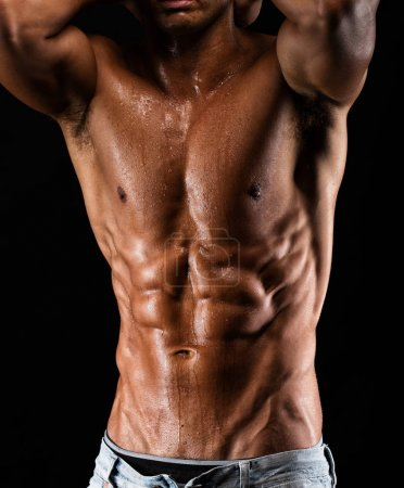 fit Man showing abs with oil and sweat