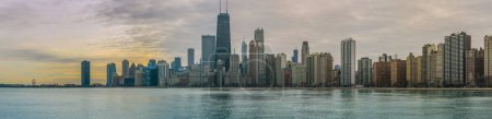 Photo for Chicago skyline Panorama Sunset with Michigan Lake in Winter - Royalty Free Image