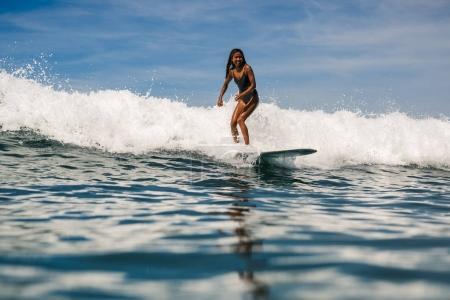 female surfer on surf board