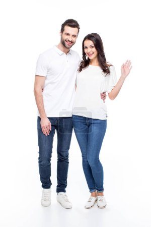 Photo for Full length portrait of beautiful young couple standing together and smiling at camera  isolated on white - Royalty Free Image