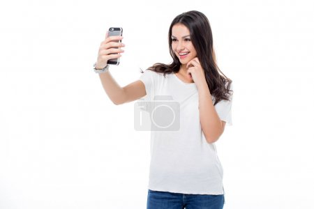 Photo pour Attractive woman making selfie on smartphone  isolated on white - image libre de droit