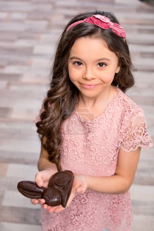 Little girl with chocolate bunny