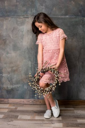 Little girl with catkins wreath