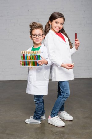 Kids holding test tubes