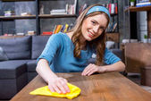 Woman cleaning table