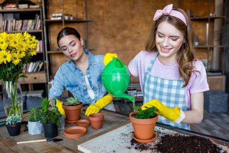 women watering plant