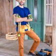 Carpenter with tools on porch