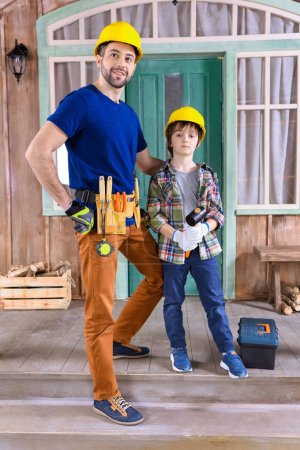 Father and son with building tools