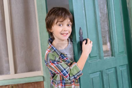 Photo for Excited boy standing in door and looking to camera - Royalty Free Image