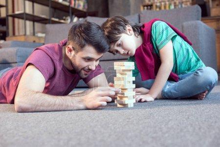 father and son playing jenga