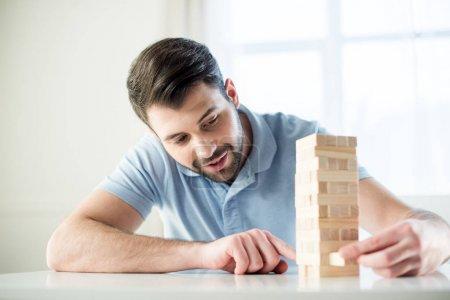Man playing jenga game