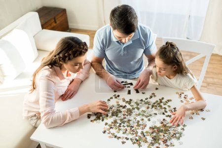 Family playing with puzzles