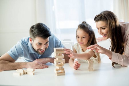 Photo for Portrait of happy family playing jenga game at home - Royalty Free Image