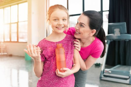 Mother and daughter with sports bottle