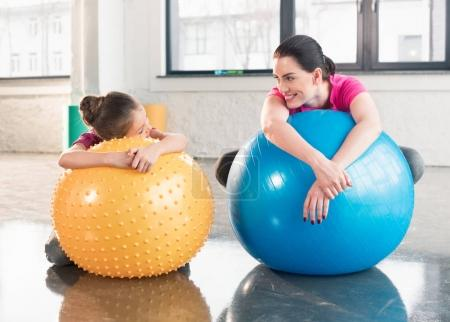 Mother and daughter with fitness balls