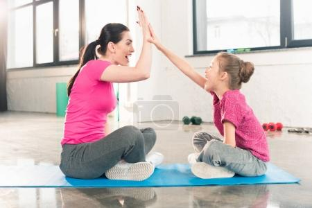 Mother and daughter in gym