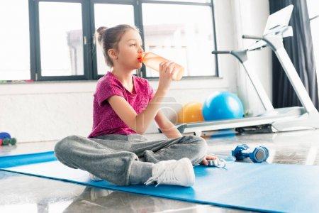 adorable girl on yoga mat
