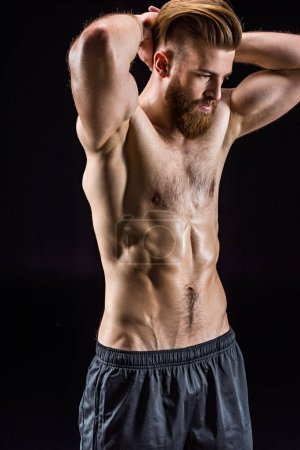 shirtless bodybuilder posing