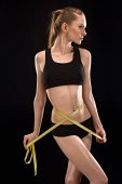 Sportswoman with measuring tape
