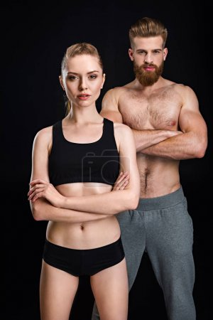 Sportswoman and sportsman posing