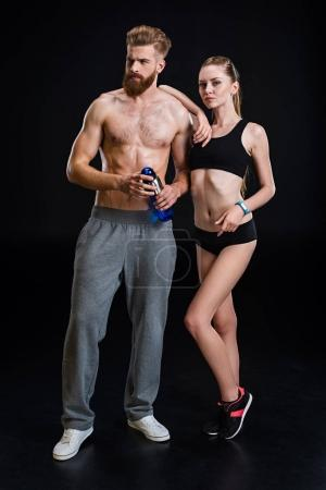 sportsman with sport bottle and sportswoman