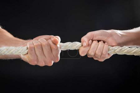 Man and woman pulling rope