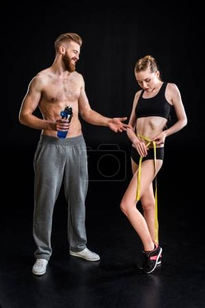 Bearded sportsman and sportswoman