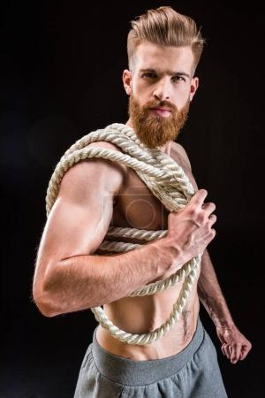 Sportsman holding rope