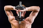 bodybuilder training with dumbbell