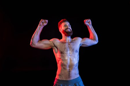 Bodybuilder celebrating triumph