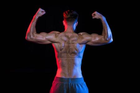 shirtless bodybuilder gesturing