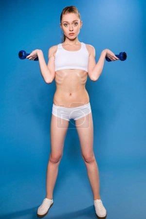 sportswoman training with dumbbells