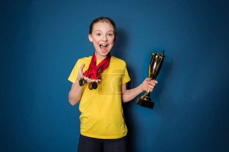 girl with medals and trophy