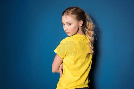 preteen girl in yellow shirt