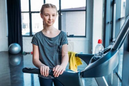 preteen girl training on treadmill