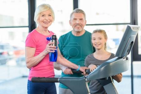 senior couple and girl on treadmill