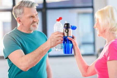 Couple drinking water in gym