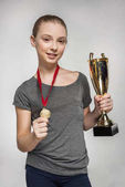 Girl with trophy and medal