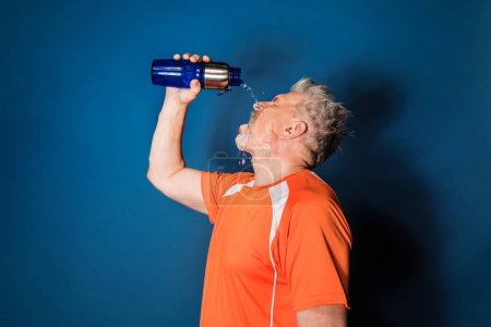Mature sportsman with bottle
