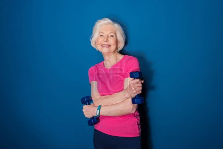 Senior woman with dumbbells