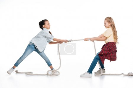 Photo for Two girls play tug of war, kids sport isolated concept - Royalty Free Image